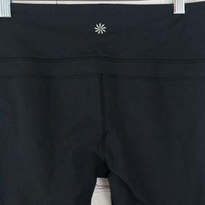 Black Athleta workout leggings with key pocket
